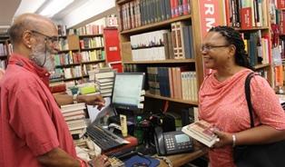 Strand long-time book clerk Ben McFall and Joycelyn Moody