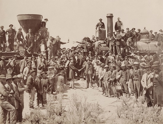 1280px-East_and_West_Shaking_hands_at_the_laying_of_last_rail_Union_Pacific_Railroad_-_Restoration.jpg