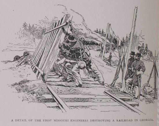 Neal Destroying Railroad Tracks 1.jpg