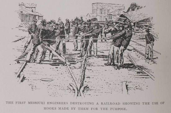 Neal Destroying Railroad Tracks 2.jpg