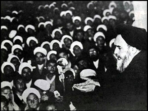 Ruhollah_Khomeini_speaking_to_his_followers_against_capitulation_day_1964.jpg